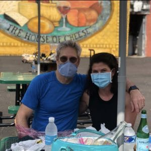 couple with masks for safety